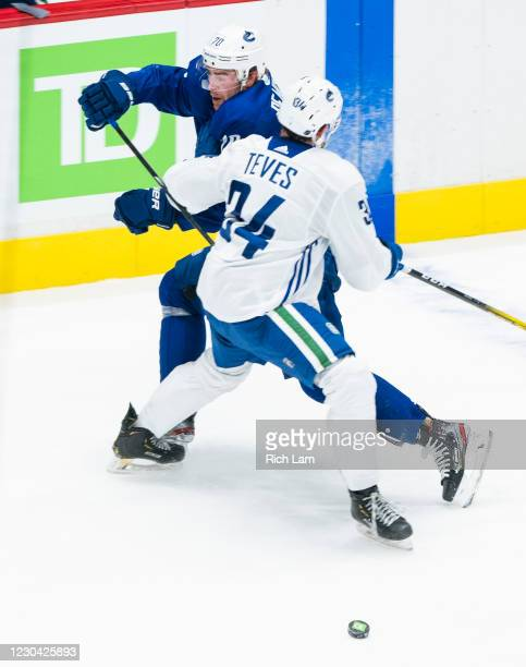 Josh Teves of the Vancouver Canucks takes out Tanner Pearson during a drill on the first day of the Vancouver Canucks NHL Training Camp at Rogers...