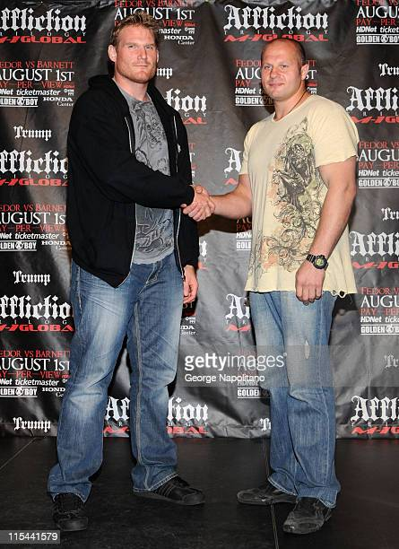 """Josh """"The Babyfaced Assassin"""" Barnett and Fedor """"The Last Emperor"""" Emelianenko attend a press conference to officially announce the Affliction M-1..."""