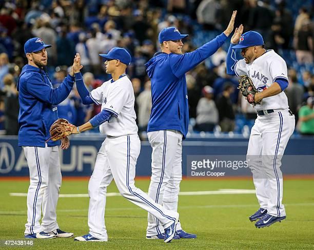 TORONTO ON MAY 6 Josh Thole Ryan Goins Michael Saunders and Devon Travis celebrate after theToronto Blue Jays beat the New York Yankees 51at the...