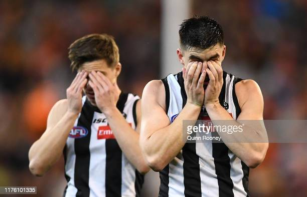 Josh Thomas and Brayden Maynard of the Magpies look dejected after losing the AFL Preliminary Final match between the Collingwood Magpies and the...