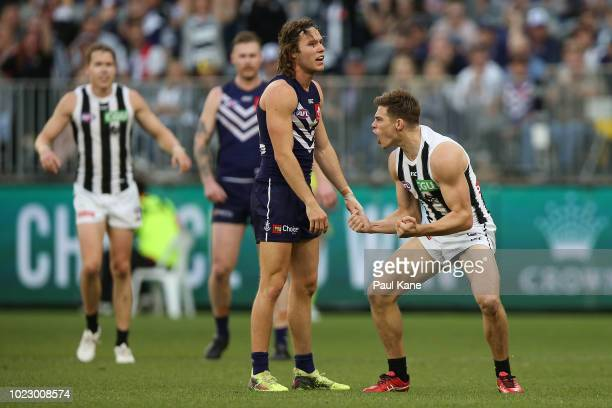 Josh Thomas of the Magpies celebrates a goal during the round 23 AFL match between the Fremantle Dockers and the Collingwood Magpies at Optus Stadium...