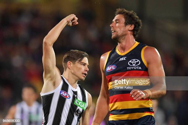 Josh Thomas of the Magpies celebrates after kicking a goal during the round four AFL match between the Adelaide Crows and the Collingwood Magpies at...