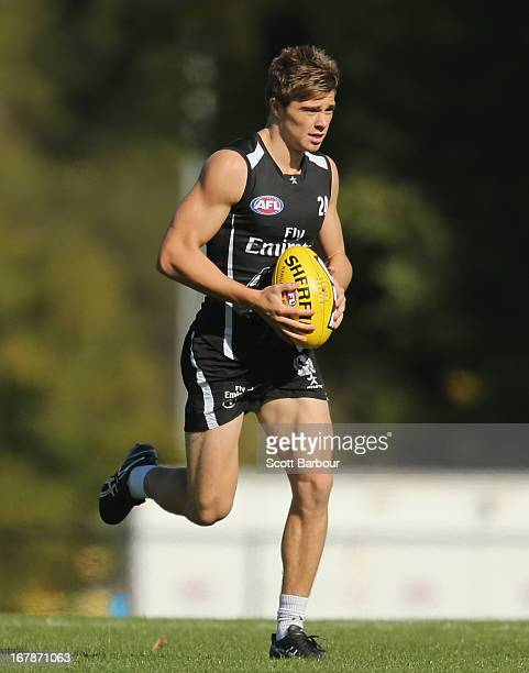Josh Thomas of the Magpies runs with the ball during a Collingwood Magpies AFL training session at Olympic Park on May 2, 2013 in Melbourne,...