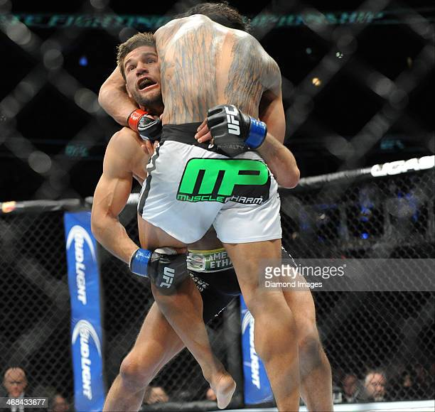 Josh Thompson attempts to stop the takedown attempt of Benson Henderson during a lightweight bout during UFC on Fox 10 Henderson v Thomson at United...