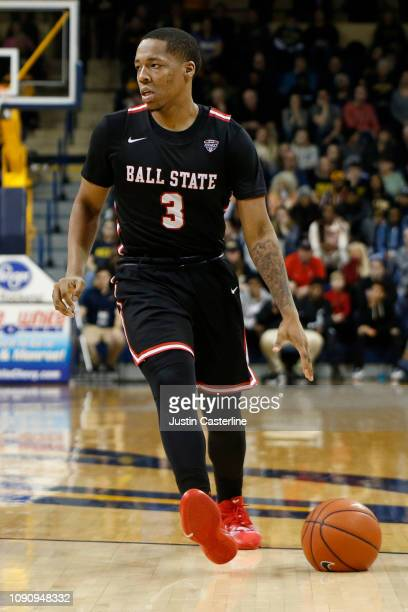 Josh Thompson of the Ball State Cardinals brings the ball up the court in the game against the Toledo Rockets during the second half at Savage Arena...