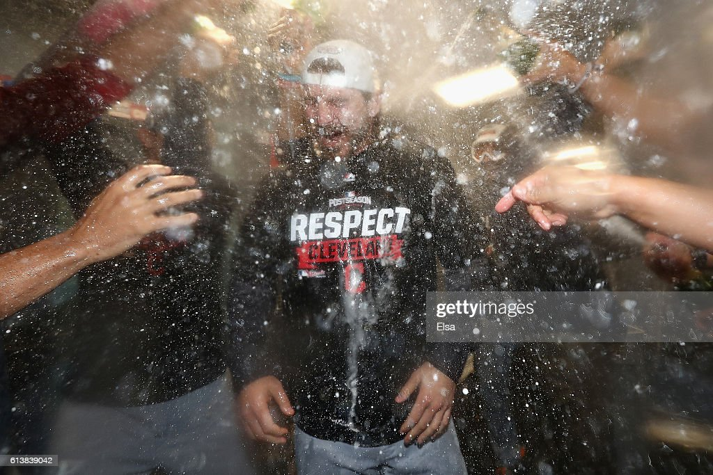 Josh Tomlin #43 of the Cleveland Indians celebrates with teammates in the clubhouse after defeating the Boston Red Sox 4-3 in game three of the American League Divison Series to advance to the American League Championship Series at Fenway Park on October 10, 2016 in Boston, Massachusetts.