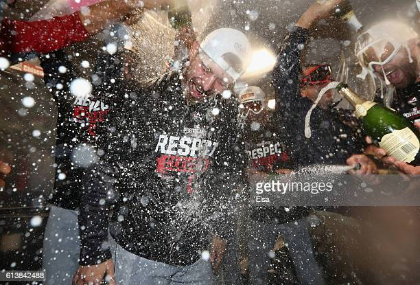 Josh Tomlin of the Cleveland Indians celebrates with teammates in the clubhouse after defeating the Boston Red Sox 4-3 in game three of the American...