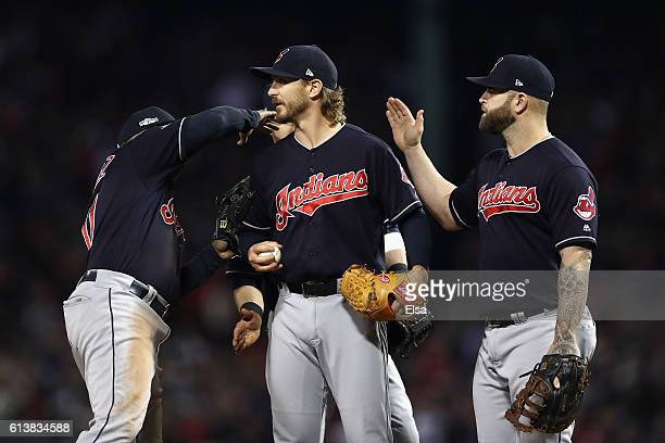 Josh Tomlin of the Cleveland Indians is congratulated by teammates as he is relieved in the sixth inning against the Boston Red Sox during game three...