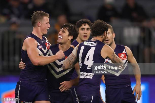 Josh Treacy and Lachie Shultz of the Dockers celebrate a goal during the round 10 AFL match between the Fremantle Dockers and the Sydney Swans at...
