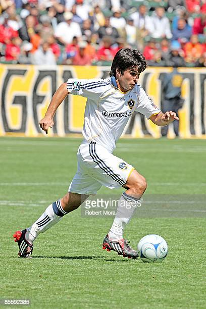 Josh Tudela of the Los Angeles Galaxy attacks the defense of DC United during the MLS game at Home Depot Center on March 22 2009 in Carson California
