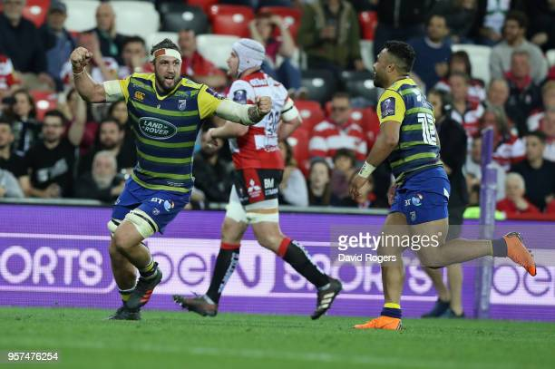 Josh Turnbull of Cardiff celebrates with team mate Willis Halaholo after their victory during the European Rugby Challenge Cup Final match between...