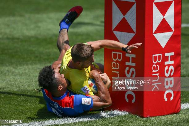 Josh Turner of Australia scores a try in the tackle of John Vaili of Samoa during the match between Australia and Samoa at the 2020 HSBC Sevens at...