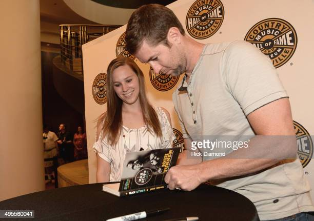 Josh Turner signs copies of his new book 'Man Stuff' at Country Music Hall of Fame and Museum on June 4 2014 in Nashville Tennessee