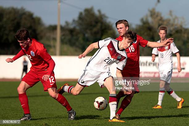 Josh Tymon and Mackenzie Heaney of England challenge DavideJerome Itter of Germany during the UEFA Under17 match between U17 England v U17 Germany on...