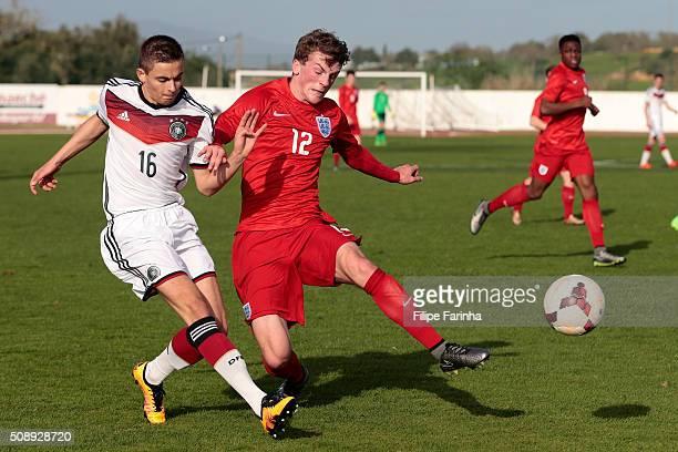Josh Tymon of England challenges Jan Baxmann of Germany during the UEFA Under17 match between U17 England v U17 Germany on February 7 2016 in Lagos...