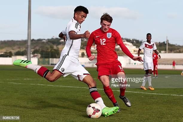 Josh Tymon of England challenges Timothy Tillman of Germany during the UEFA Under17 match between U17 England v U17 Germany on February 7 2016 in...