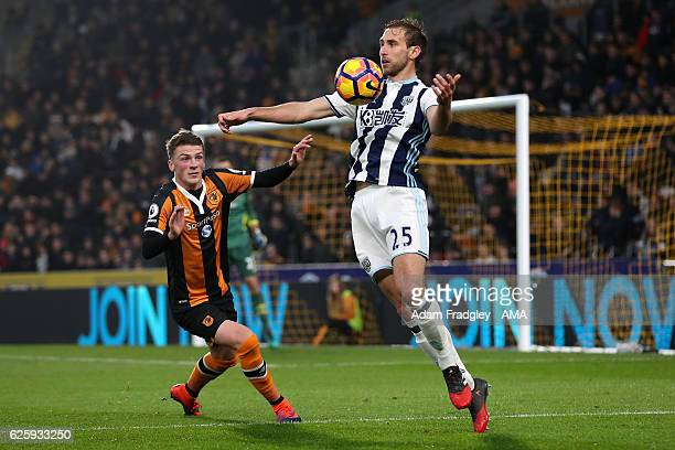 Josh Tymon of Hull City and Craig Dawson of West Bromwich Albion in action during the Premier League match between Hull City and West Bromwich Albion...