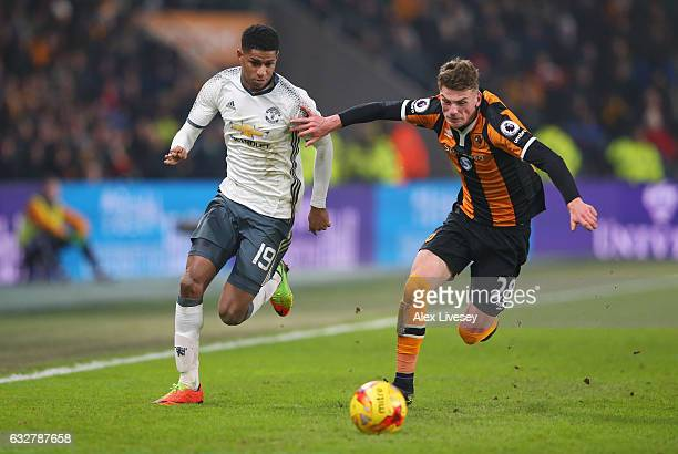 Josh Tymon of Hull City and Marcus Rashford of Manchester United battle for the ball during the EFL Cup SemiFinal second leg match between Hull City...