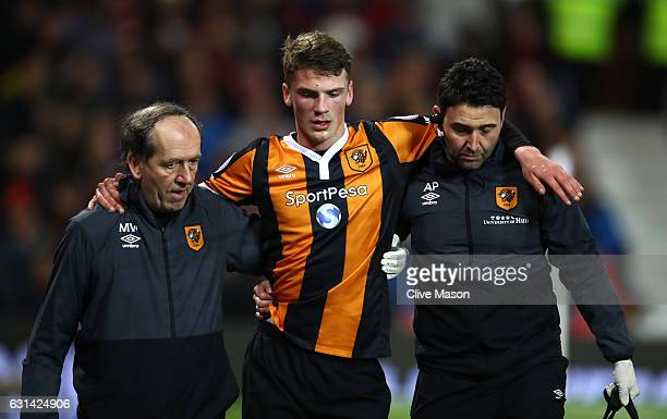Josh Tymon of Hull City leaves the pitch following an injury during the EFL Cup SemiFinal First Leg match between Manchester United and Hull City at...