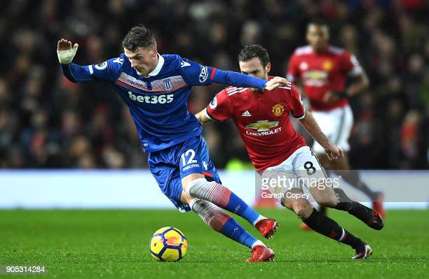 Josh Tymon of Stoke City and Juan Mata of Manchester United battle for the ball during the Premier League match between Manchester United and Stoke...