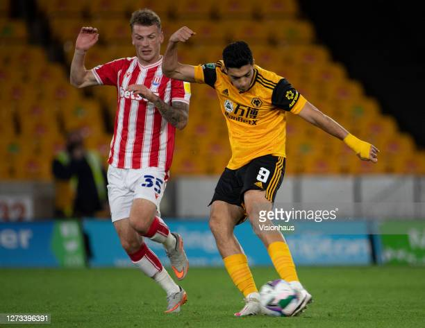 Josh Tymon of Stoke City fails to prevent Raúl Jiménez of Wolverhampton Wanderers getting his shot away during the Carabao Cup second round match...