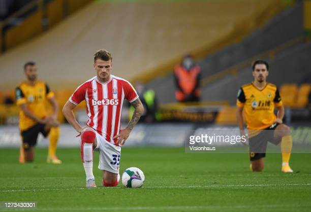Josh Tymon of Stoke City takes a knee prior to the Carabao Cup second round match between Wolverhampton Wanderers and Stoke City at Molineux on...