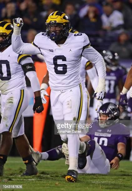Josh Uche of the Michigan Wolverines celebrates a sack against Clayton Thorson of the Northwestern Wildcats at Ryan Field on September 29 2018 in...