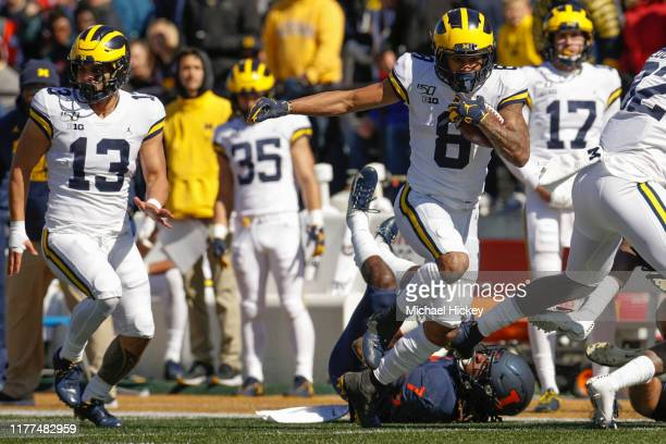 Josh Uche of the Michigan Wolverines runs the ball during the game against the Illinois Fighting Illini at Memorial Stadium on October 12 2019 in...