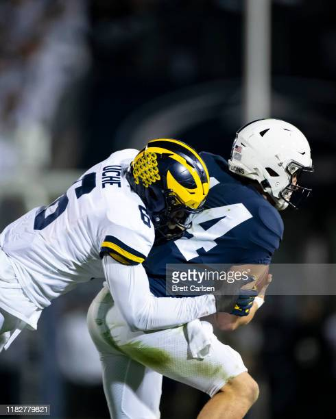 Josh Uche of the Michigan Wolverines sacks Sean Clifford of the Penn State Nittany Lions during the third quarter on October 19 2019 at Beaver...