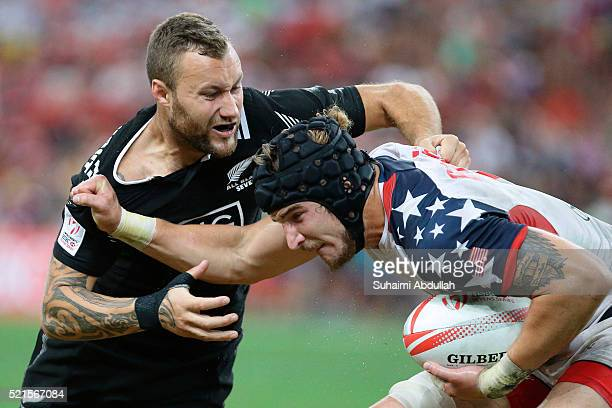 Josh Van Lieshout of New Zealand challenges Garrett Bender of United States of America for the ball during the 2016 Singapore Sevens at National...