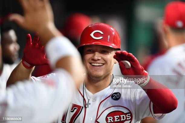 Josh VanMeter of the Cincinnati Reds celebrates in the dugout after hitting a tworun home run in the seventh inning against the St Louis Cardinals at...