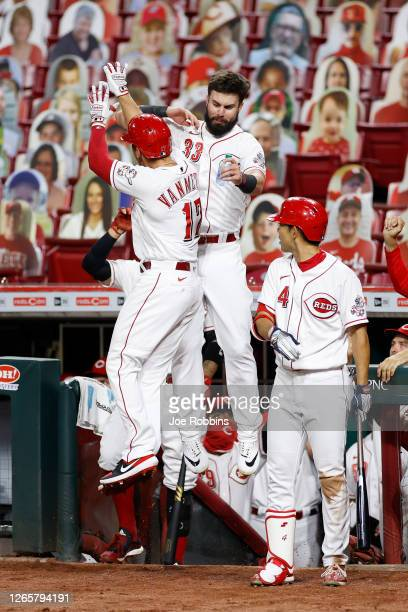 Josh VanMeter of the Cincinnati Reds celebrates with Jesse Winker after hitting a home run in the seventh inning against the Kansas City Royals at...