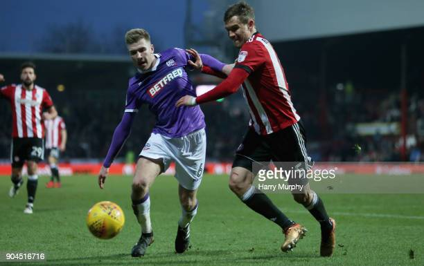 Josh Vela of Bolton Wanderers and Andreas Bjelland of Brentford battle for possession during the Sky Bet Championship match between Brentford and...