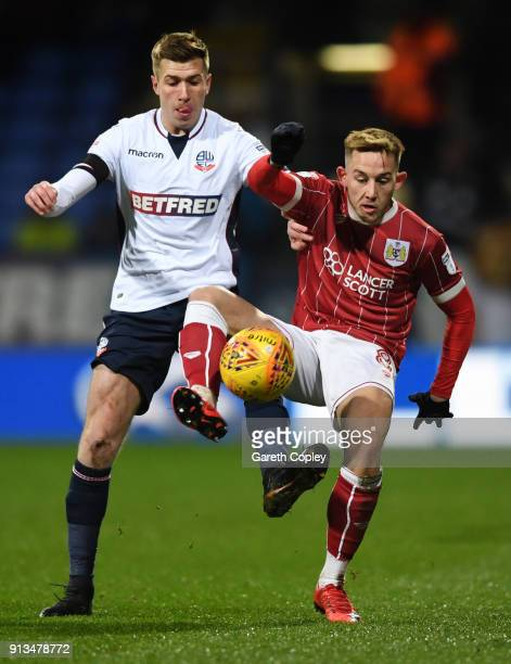 Josh Vela of Bolton Wanderers battles for the ball with Josh Brownhill of Bristol City during the Sky Bet Championship match between Bolton Wanderers...