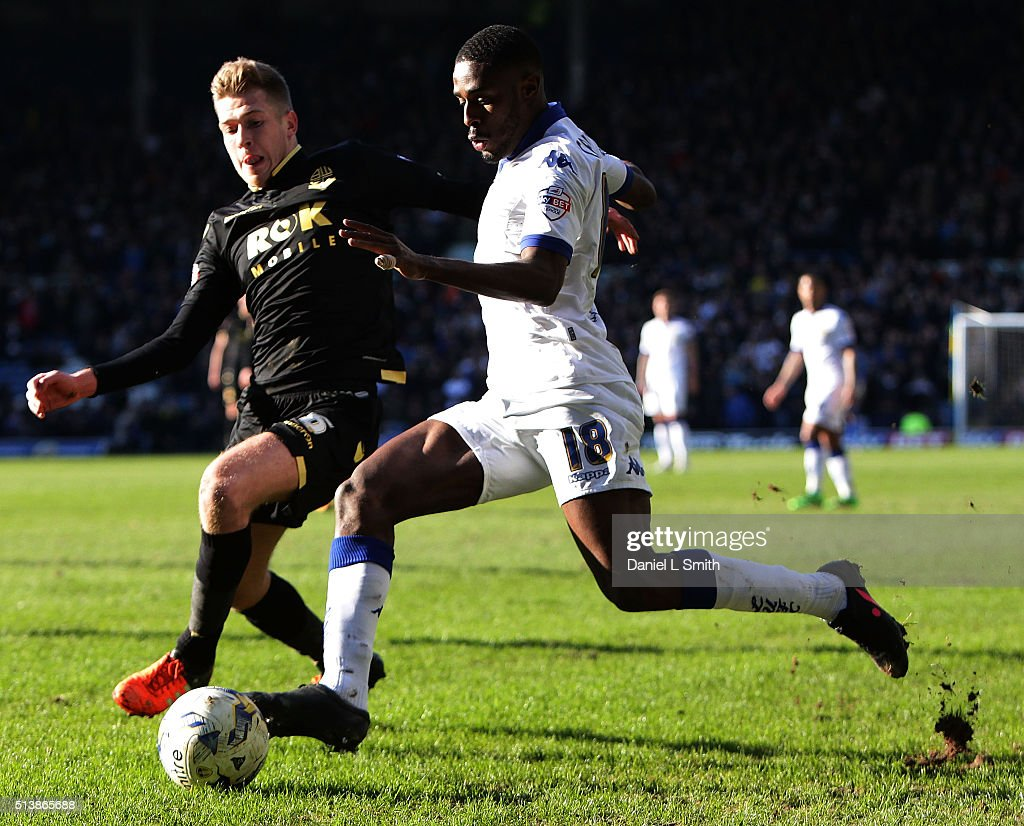 Josh Vela of Bolton Wanderers FC tackles Mustapha Carayol of Leeds United FC for the ball during the Sky Bet Championship League match between Leeds United and Bolton Wanderers at Elland Road Stadium on March 5, 2016 in Leeds, United Kingdom.