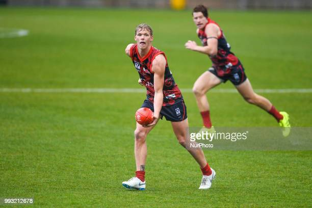 Josh Wagner of the Casey Demons runs with the ball during the VFL round 14 game between the Casey Demons and North Melbourne at Casey Fields in...