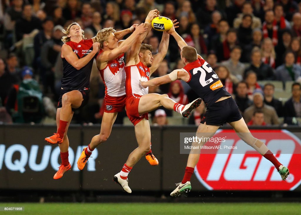 Josh Wagner of the Demons, Isaac Heeney of the Swans, Luke Parker of the Swans and Tom McDonald of the Demons compete for the ball during the 2017 AFL round 15 match between the Melbourne Demons and the Sydney Swans at the Melbourne Cricket Ground on June 30, 2017 in Melbourne, Australia. (Photo by Michael Willson/AFL Media/Getty Images))