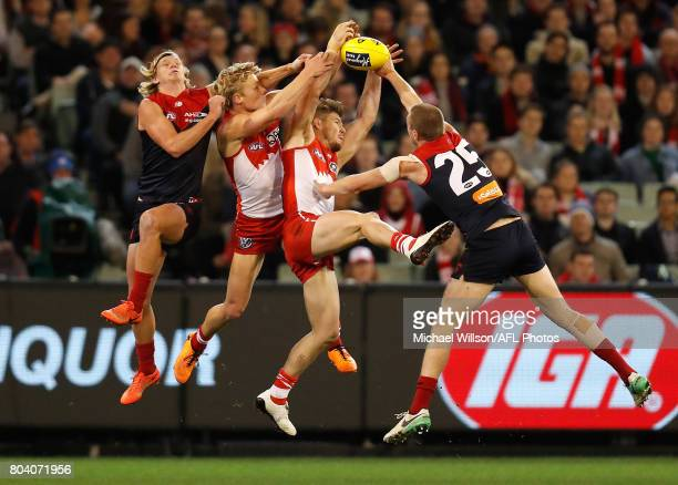 Josh Wagner of the Demons, Isaac Heeney of the Swans, Luke Parker of the Swans and Tom McDonald of the Demons compete for the ball during the 2017...