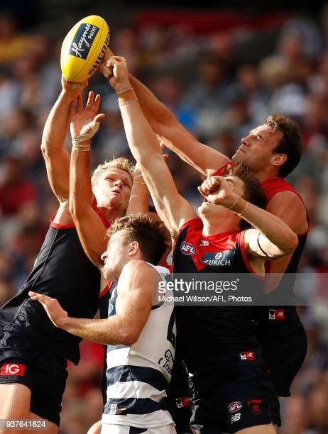 Josh Wagner of the Demons Jordan Murdoch of the Cats Jake Lever of the Demons and Cameron Pedersen of the Demons compete for the ball during the 2018...