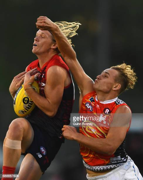 Josh Wagner of the Demons marks infront of Will Brodie of the Suns during the round ten AFL match between the Melbourne Demons and the Gold Coast...