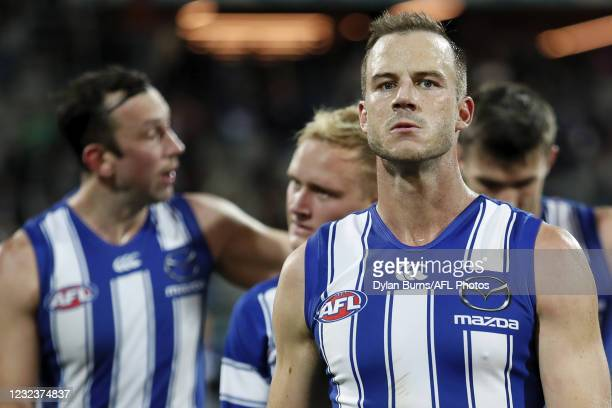 Josh Walker of the Kangaroos reacts after a loss during the 2021 AFL Round 05 match between the Geelong Cats and the North Melbourne Kangaroos at...