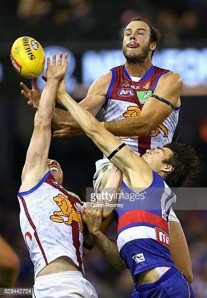 Josh Walker of the Lions attempts to mark over the top of Easton Wood of the Bulldogs during the round five AFL match between the Western Bulldogs...