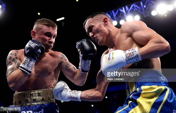 Josh Warrington and Carl Frampton exchange punches during the IBF World Featherweight Championship title fight between Josh Warrington and Carl...