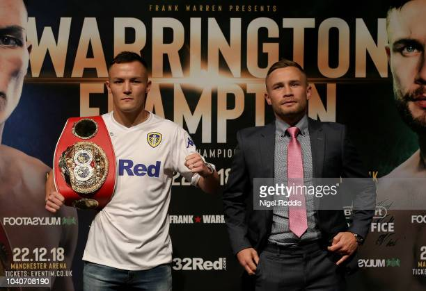 Josh Warrington face off with Carl Frampton during a press conference for the Josh Warrington and Carl Frampton Media Tour on September 26 2018 in...