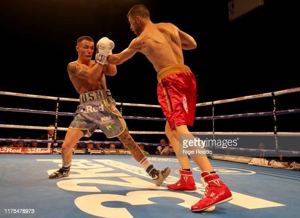 Josh Warrington in action with Sofiane Takoucht during the IBF world featherweight Title Fight between Josh Warrington and Sofiane Takoucht at the...