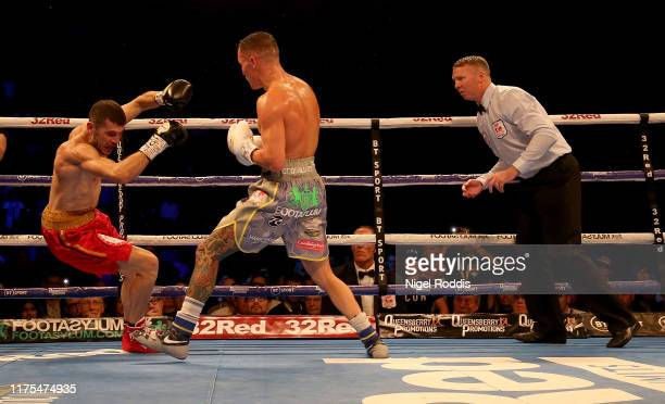 Josh Warrington knocks down Sofiane Takoucht during the IBF world featherweight Title Fight between Josh Warrington and Sofiane Takoucht at the First...
