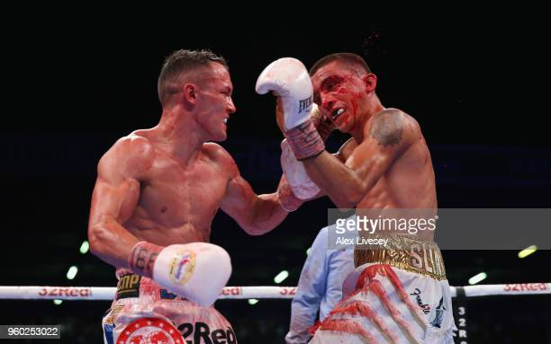 Josh Warrington lands a left shot on Lee Selby during IBF Featherweight Championship fight at Elland Road on May 19 2018 in Leeds England