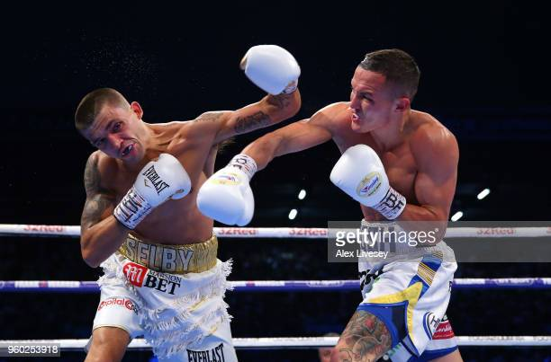 Josh Warrington lands a right shot on Lee Selby during IBF Featherweight Championship fight at Elland Road on May 19 2018 in Leeds England