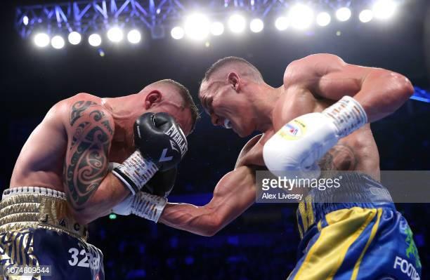 Josh Warrington punches Carl Frampton during the IBF World Featherweight Championship title fight between Josh Warrington and Carl Frampton at...