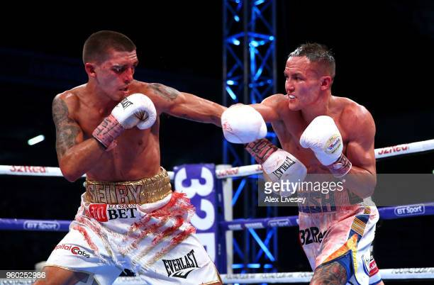 Josh Warrington throws a right shot at Lee Selby during IBF Featherweight Championship fight at Elland Road on May 19 2018 in Leeds England